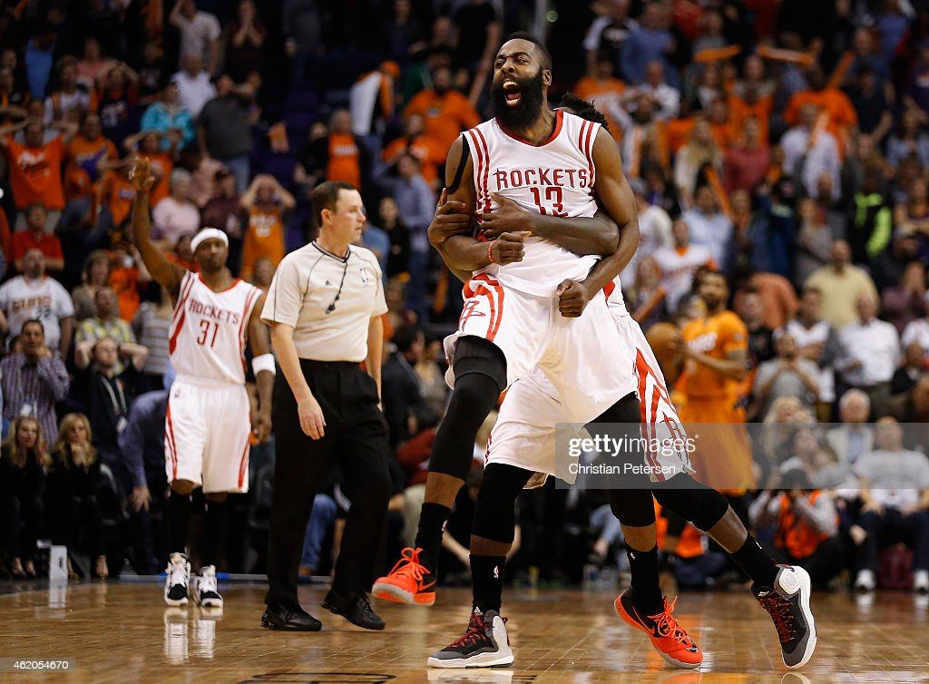 James Harden of the Houston Rockets celebrates after making the game winning shot to defeat the Phoenix Suns during the final seconds of the NBA game...
