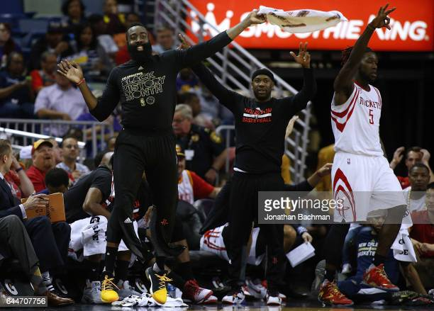 James Harden of the Houston Rockets celebrates from the bench during the second half of a game against the New Orleans Pelicans at the Smoothie King...