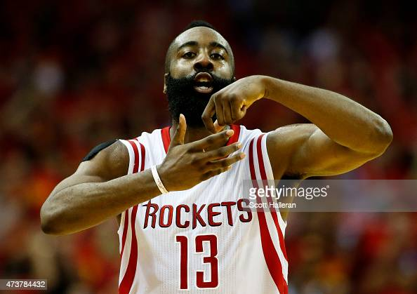 James Harden of the Houston Rockets celebrates in the fourth quarter against the Los Angeles Clippers during Game Seven of the Western Conference...