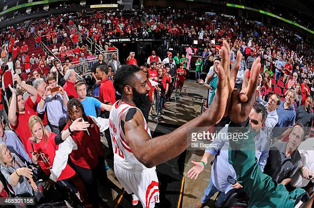 James Harden of the Houston Rockets celebrates with fans after scoring a careerhigh 51 points in a victory over the Sacramento Kings on April 1 2015...