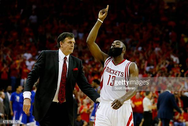 James Harden of the Houston Rockets celebrates with head coach Kevin McHale after they defeated the Los Angeles Clippers 113 to 100 during Game Seven...