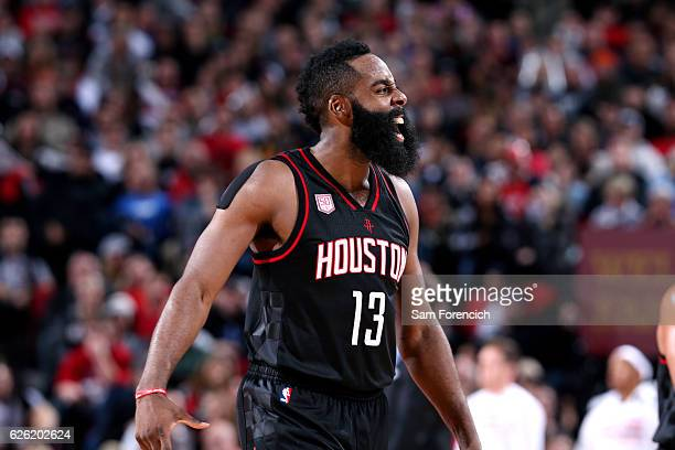 James Harden of the Houston Rockets cheers during the game against the Portland Trail Blazers on November 27 2016 at the Moda Center in Portland...