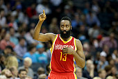 James Harden of the Houston Rockets comes back into the game against the Charlotte Hornets during their game at Time Warner Cable Arena on April 13...