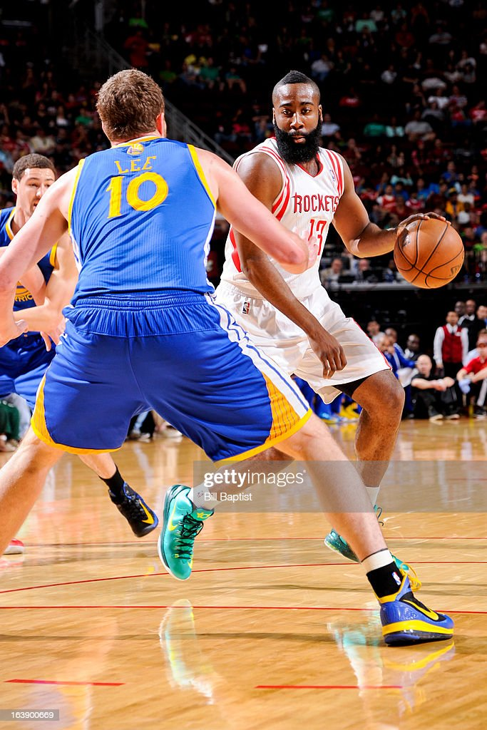 James Harden #13 of the Houston Rockets controls the ball against David Lee #10 of the Golden State Warriors on March 17, 2013 at the Toyota Center in Houston, Texas.