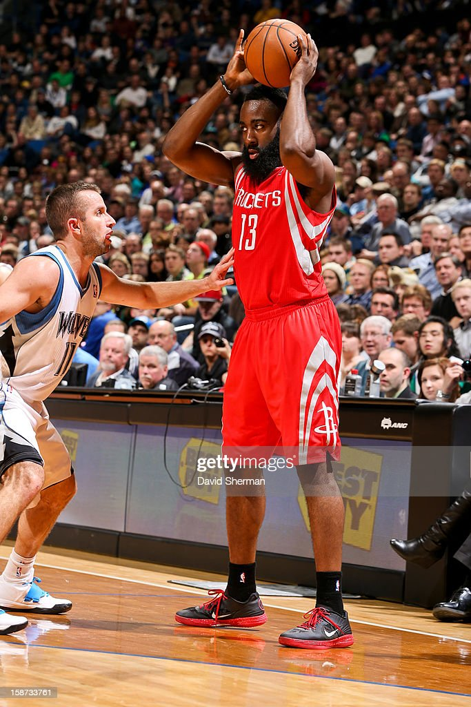 James Harden #13 of the Houston Rockets controls the ball against Jose Juan Barea #11 of the Minnesota Timberwolves on December 26, 2012 at Target Center in Minneapolis, Minnesota.