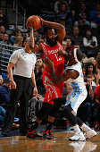 James Harden of the Houston Rockets controls the ball against Ty Lawson of the Denver Nuggets at Pepsi Center on March 7 2015 in Denver Colorado The...