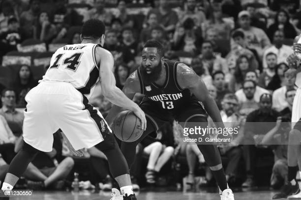 James Harden of the Houston Rockets defends against Danny Green of the San Antonio Spurs during Game Five of the Western Conference Semifinals of the...