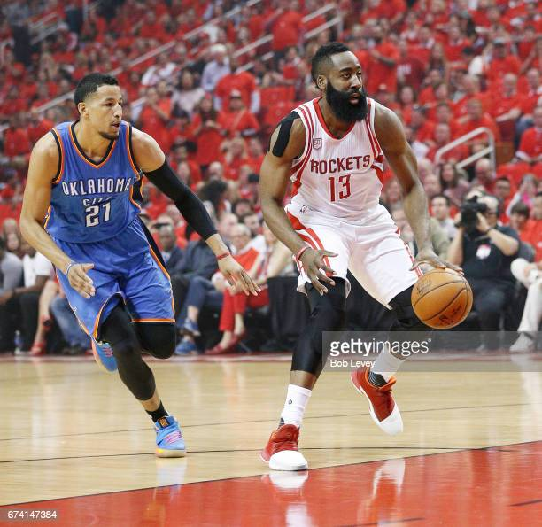 James Harden of the Houston Rockets dribbles past Andre Roberson of the Oklahoma City Thunder during Game Five of the Western Conference...