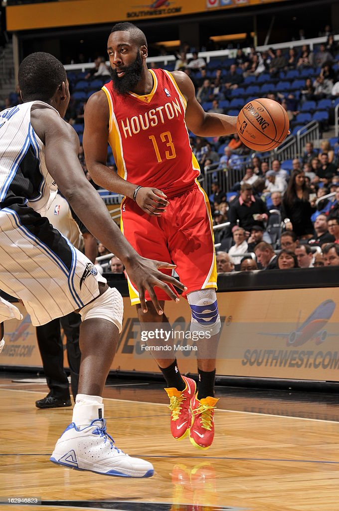 James Harden #13 of the Houston Rockets dribbles the ball against the Orlando Magic during the game on March 1, 2013 at Amway Center in Orlando, Florida.
