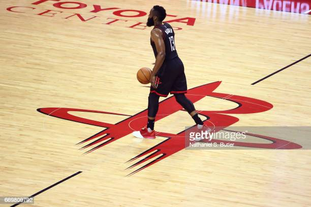 James Harden of the Houston Rockets dribbles the ball up court during the Western Conference Quarterfinals game against the Oklahoma City Thunder...