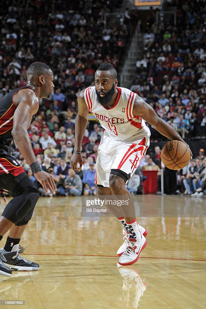 <a gi-track='captionPersonalityLinkClicked' href=/galleries/search?phrase=James+Harden&family=editorial&specificpeople=4215938 ng-click='$event.stopPropagation()'>James Harden</a> #13 of the Houston Rockets dribbles the ball upcourt against <a gi-track='captionPersonalityLinkClicked' href=/galleries/search?phrase=Dwyane+Wade&family=editorial&specificpeople=201481 ng-click='$event.stopPropagation()'>Dwyane Wade</a> #3 of the Miami Heat on November 12, 2012 at the Toyota Center in Houston, Texas.
