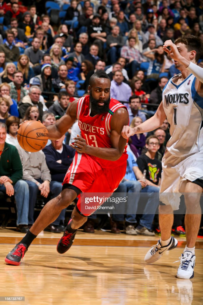 James Harden #13 of the Houston Rockets drives against Alexey Shved #1 of the Minnesota Timberwolves on December 26, 2012 at Target Center in Minneapolis, Minnesota.