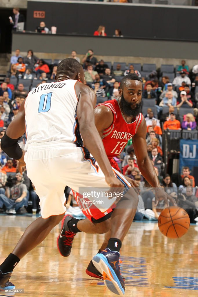 James Harden #13 of the Houston Rockets drives against Bismack Biyombo #0 of the Charlotte Bobcats at the Time Warner Cable Arena on January 21, 2013 in Charlotte, North Carolina.