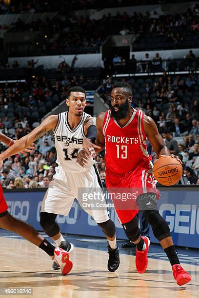 James Harden of the Houston Rockets drives against Danny Green of the San Antonio Spurs at the ATT Center on October 23 2015 in San Antonio Texas...