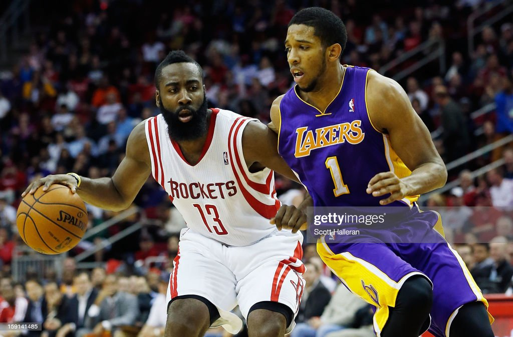 <a gi-track='captionPersonalityLinkClicked' href=/galleries/search?phrase=James+Harden&family=editorial&specificpeople=4215938 ng-click='$event.stopPropagation()'>James Harden</a> #13 of the Houston Rockets drives against Darius Morris #1 of the Los Angeles Lakers at Toyota Center on January 8, 2013 in Houston, Texas.