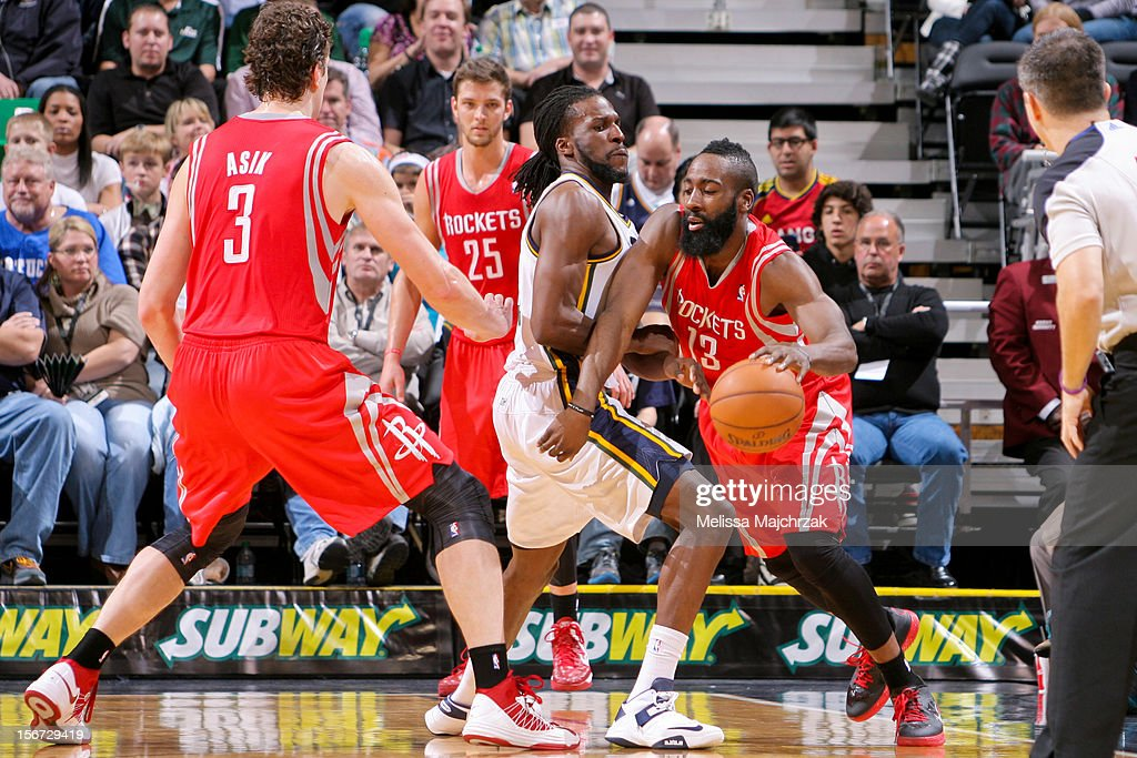James Harden #13 of the Houston Rockets drives against DeMarre Carroll #3 of the Utah Jazz at Energy Solutions Arena on November 19, 2012 in Salt Lake City, Utah.