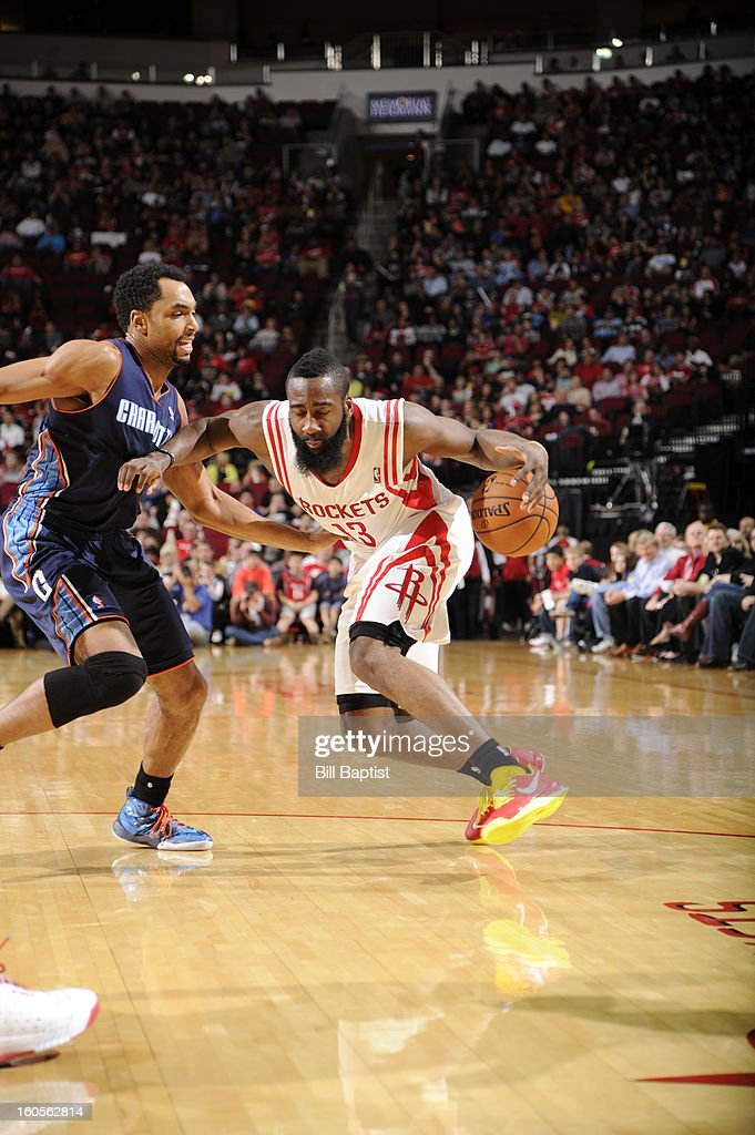 James Harden #13 of the Houston Rockets drives against Gerald Henderson #9 of the Charlotte Bobcats on February 2, 2013 at the Toyota Center in Houston, Texas.