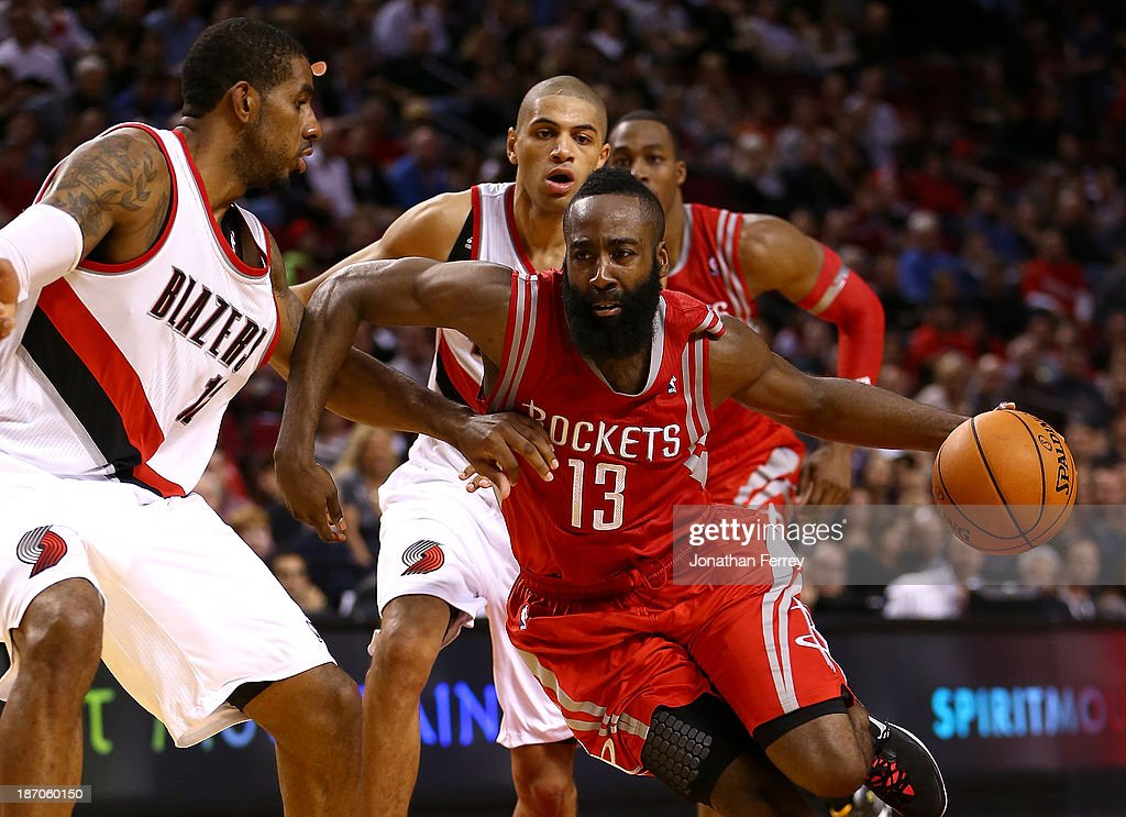 <a gi-track='captionPersonalityLinkClicked' href=/galleries/search?phrase=James+Harden&family=editorial&specificpeople=4215938 ng-click='$event.stopPropagation()'>James Harden</a> #13 of the Houston Rockets drives against <a gi-track='captionPersonalityLinkClicked' href=/galleries/search?phrase=LaMarcus+Aldridge&family=editorial&specificpeople=453277 ng-click='$event.stopPropagation()'>LaMarcus Aldridge</a> #12 of the Portland Trail Blazers on November 5, 2013 at the Moda Center in Portland, Oregon.