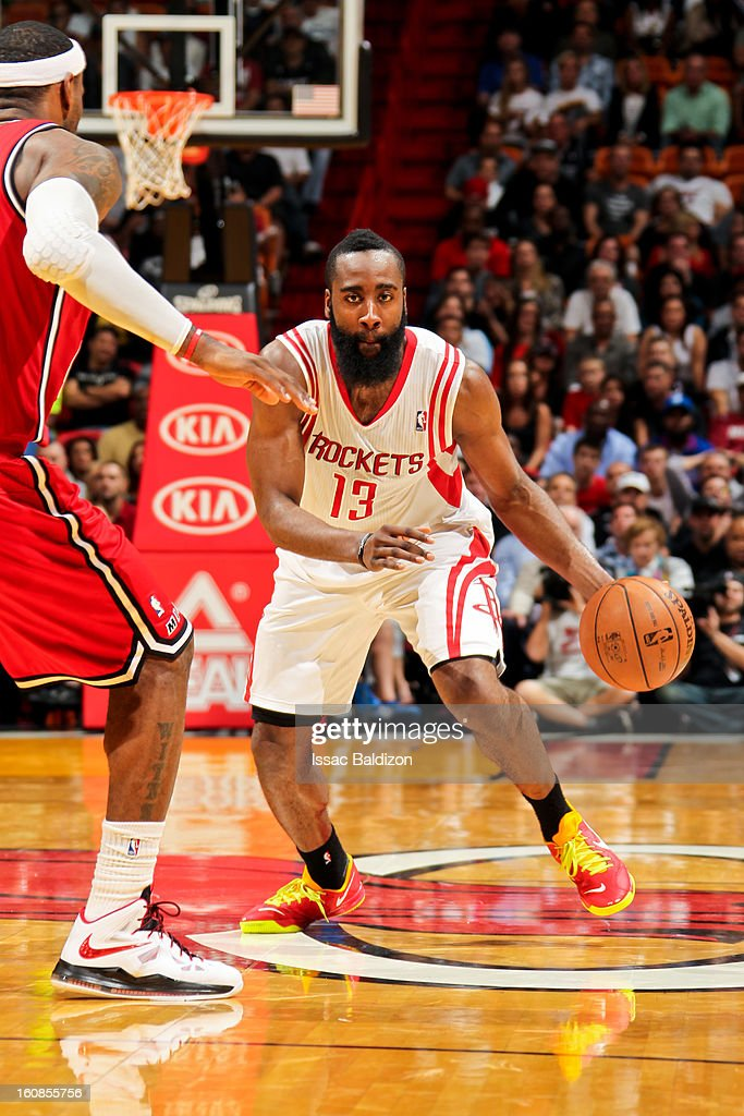 James Harden #13 of the Houston Rockets drives against LeBron James #6 of the Miami Heat on February 6, 2013 at American Airlines Arena in Miami, Florida.