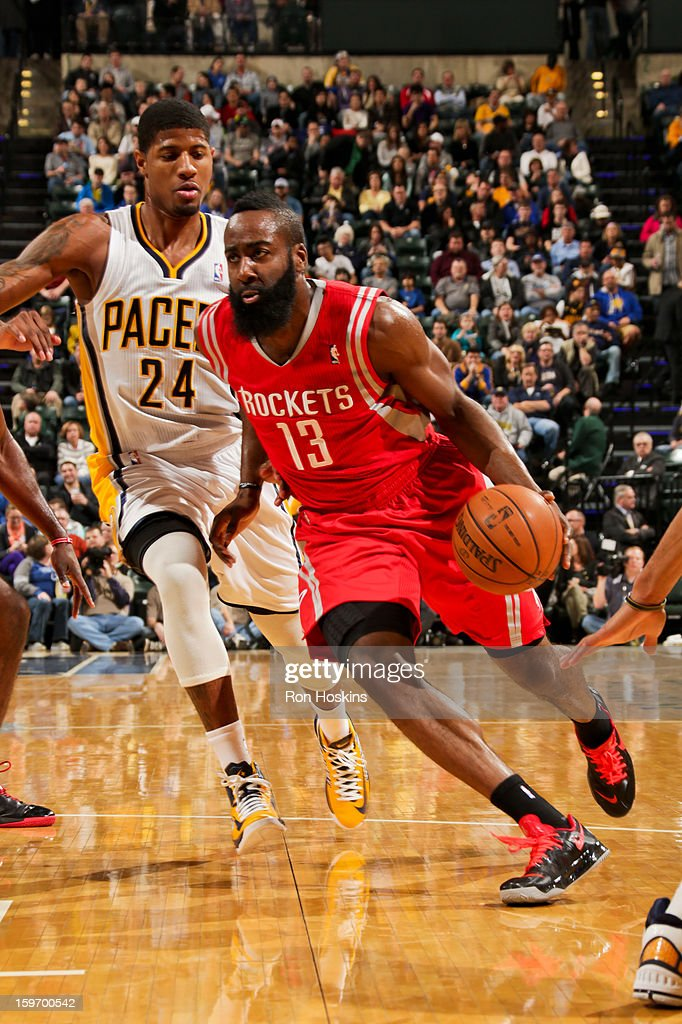 James Harden #13 of the Houston Rockets drives ahead of Paul George #24 of the Indiana Pacers on January 18, 2013 at Bankers Life Fieldhouse in Indianapolis, Indiana.