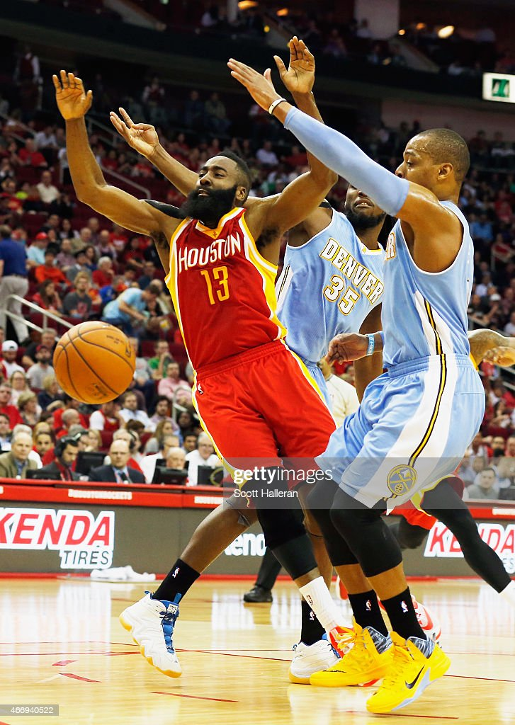 <a gi-track='captionPersonalityLinkClicked' href=/galleries/search?phrase=James+Harden&family=editorial&specificpeople=4215938 ng-click='$event.stopPropagation()'>James Harden</a> #13 of the Houston Rockets drives between <a gi-track='captionPersonalityLinkClicked' href=/galleries/search?phrase=Kenneth+Faried&family=editorial&specificpeople=5765135 ng-click='$event.stopPropagation()'>Kenneth Faried</a> #35 and <a gi-track='captionPersonalityLinkClicked' href=/galleries/search?phrase=Randy+Foye&family=editorial&specificpeople=240185 ng-click='$event.stopPropagation()'>Randy Foye</a> #4 of the Denver Nuggets during their game at the Toyota Center on March 19, 2015 in Houston, Texas.