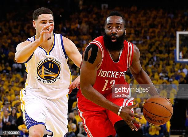 James Harden of the Houston Rockets drives on Klay Thompson of the Golden State Warriors in the first half during game five of the Western Conference...