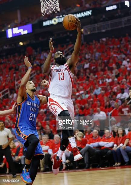 James Harden of the Houston Rockets drives past Andre Roberson of the Oklahoma City Thunder for a layup during Game Five of the Western Conference...