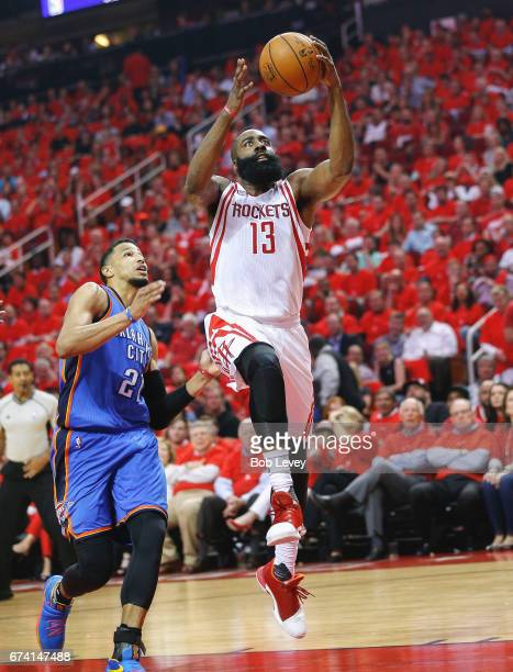 James Harden of the Houston Rockets drives past Andre Roberson of the Oklahoma City Thunder during Game Five of the Western Conference Quarterfinals...