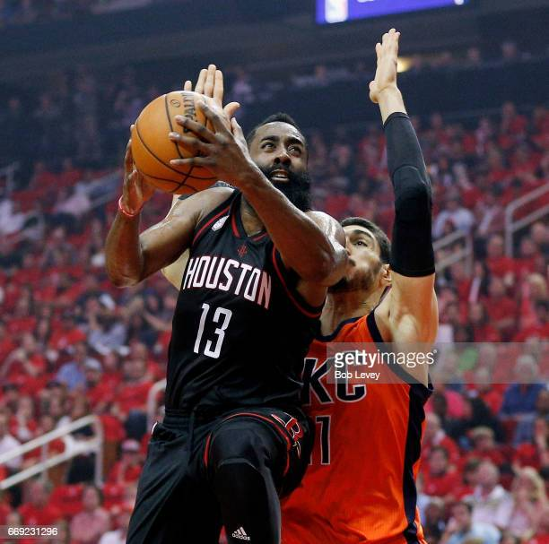 James Harden of the Houston Rockets drives past Enes Kanter of the Oklahoma City Thunder for a layup during the first quarter during Game One of the...