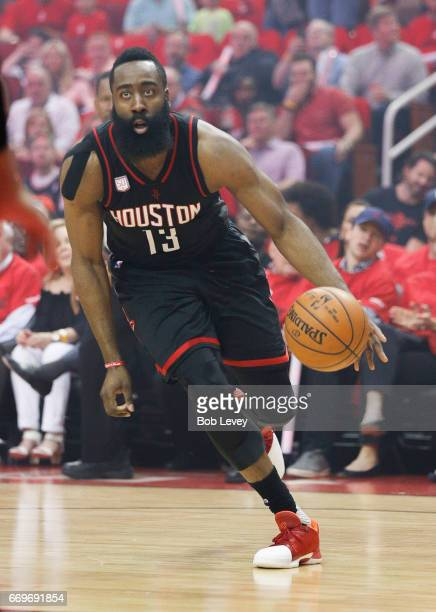James Harden of the Houston Rockets drives the ball against the Oklahoma City Thunder during Game One of the first round of the Western Conference...