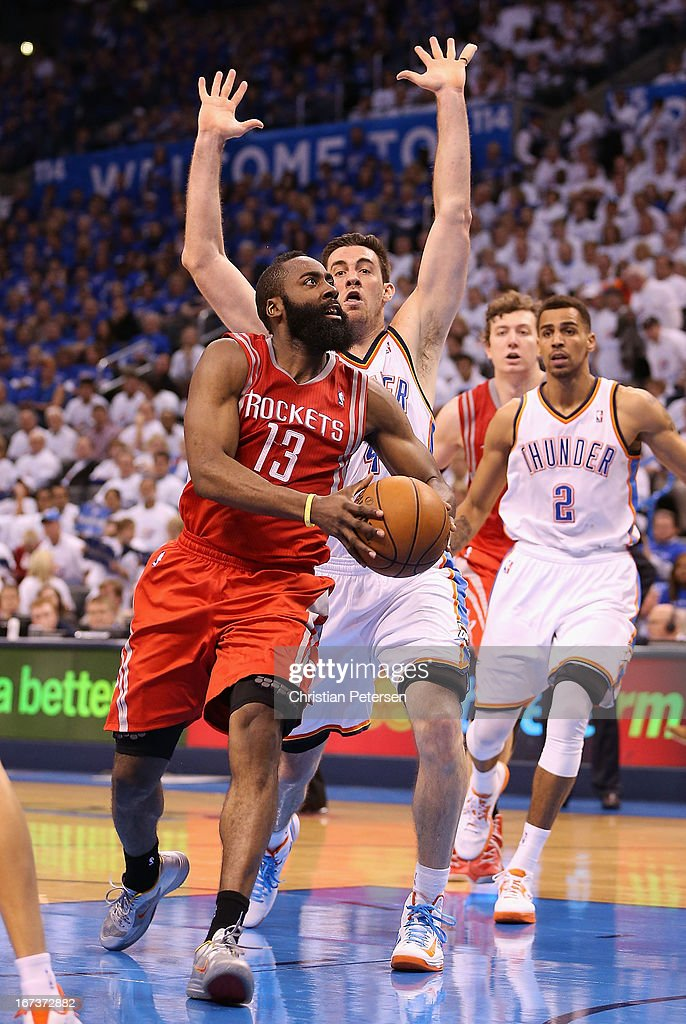 James Harden #13 of the Houston Rockets drives the ball past Nick Collison #4 of the Oklahoma City Thunder during the second half of Game Two of the Western Conference Quarterfinals of the 2013 NBA Playoffs at Chesapeake Energy Arena on April 24, 2013 in Oklahoma City, Oklahoma. The Thunder defeated the Rockets 105-102.