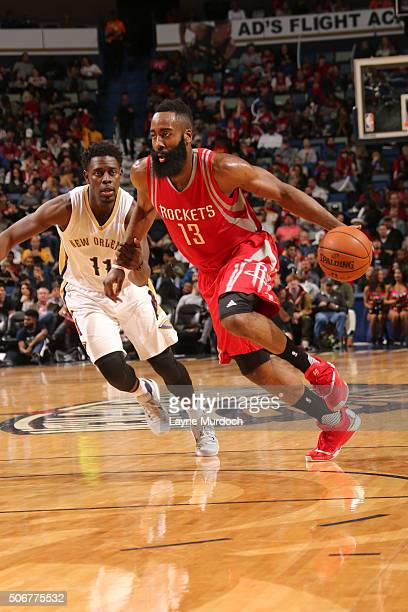 James Harden of the Houston Rockets drives to the basket against Jrue Holiday of the New Orleans Pelicans on January 25 2016 at the Smoothie King...