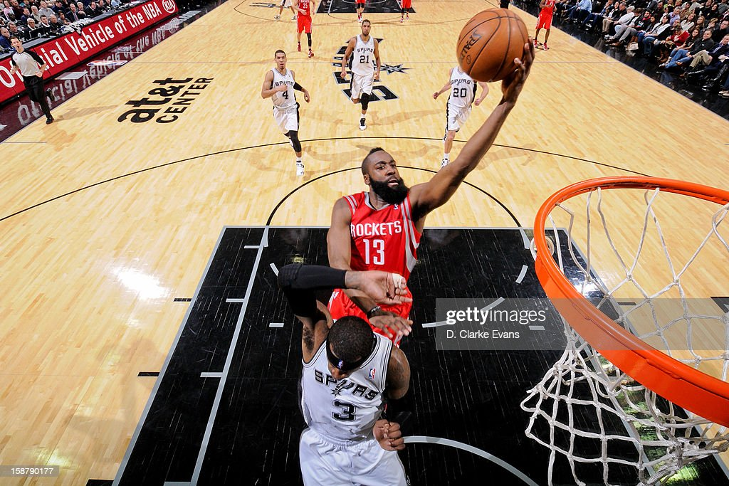 <a gi-track='captionPersonalityLinkClicked' href=/galleries/search?phrase=James+Harden&family=editorial&specificpeople=4215938 ng-click='$event.stopPropagation()'>James Harden</a> #13 of the Houston Rockets drives to the basket against Stephen Jackson #3 of the San Antonio Spurs on December 28, 2012 at the AT&T Center in San Antonio, Texas.