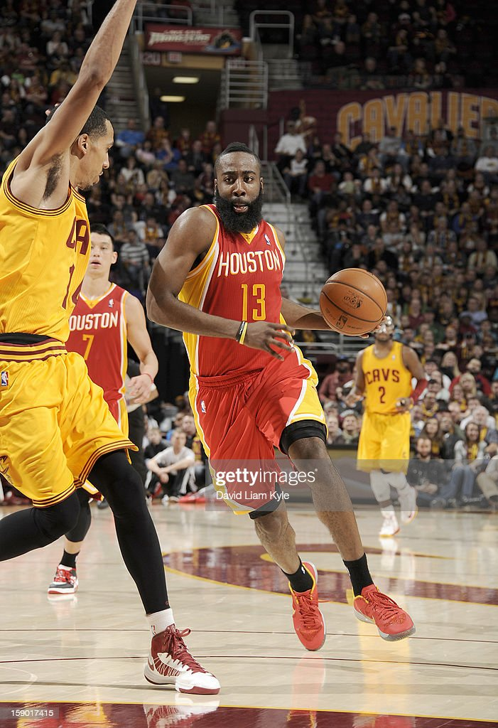 James Harden #13 of the Houston Rockets drives to the basket against Shaun Livingston #14 of the Cleveland Cavaliers at The Quicken Loans Arena on January 5, 2013 in Cleveland, Ohio.