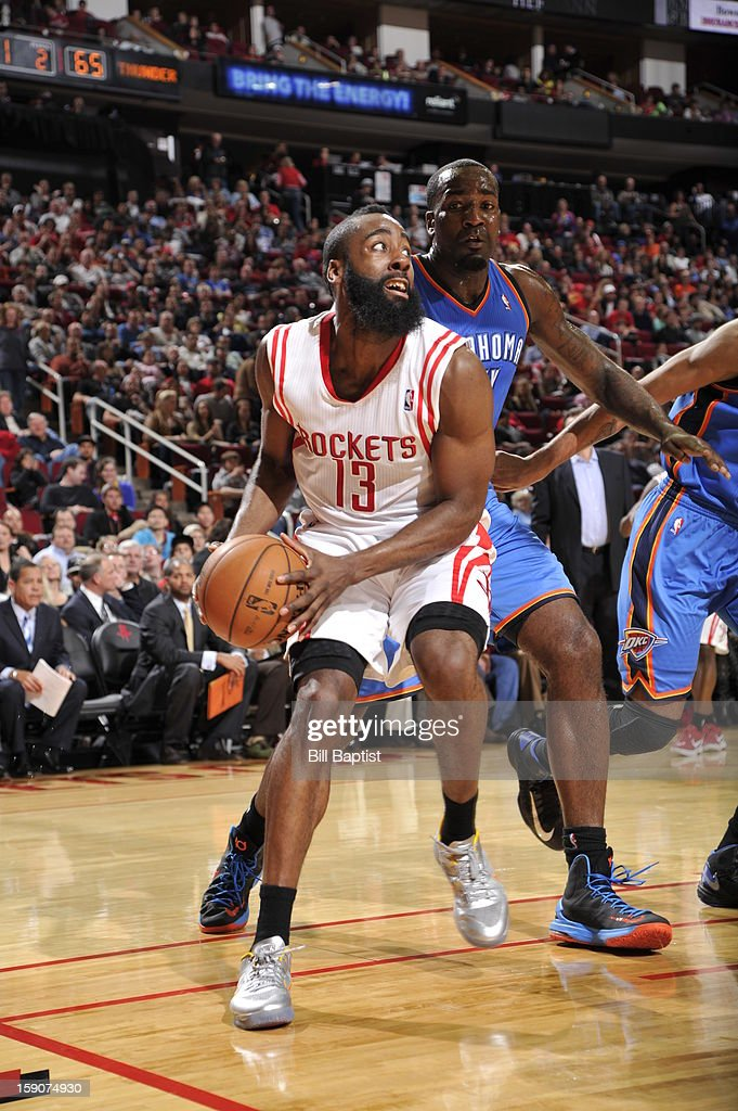 James Harden #13 of the Houston Rockets drives to the basket against Serge Ibaka #9 of the Oklahoma City Thunder on December 29, 2012 at the Toyota Center in Houston, Texas.