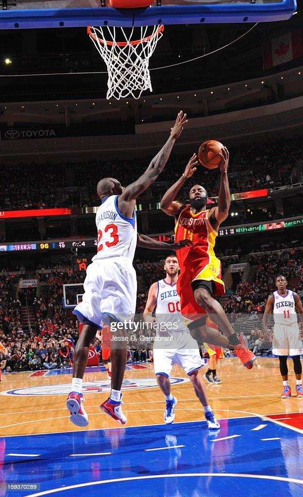 James Harden #13 of the Houston Rockets drives to the basket against Jason Richardson #23 of the Philadelphia 76ers during the game at the Wells Fargo Center on January 12, 2013 in Philadelphia, Pennsylvania.