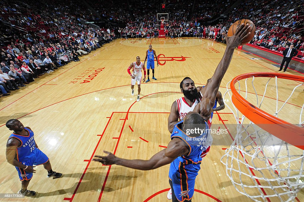 <a gi-track='captionPersonalityLinkClicked' href=/galleries/search?phrase=James+Harden&family=editorial&specificpeople=4215938 ng-click='$event.stopPropagation()'>James Harden</a> #13 of the Houston Rockets drives to the basket against <a gi-track='captionPersonalityLinkClicked' href=/galleries/search?phrase=Serge+Ibaka&family=editorial&specificpeople=5133378 ng-click='$event.stopPropagation()'>Serge Ibaka</a> #9 of the Oklahoma City Thunder on January 16, 2014 at the Toyota Center in Houston, Texas.