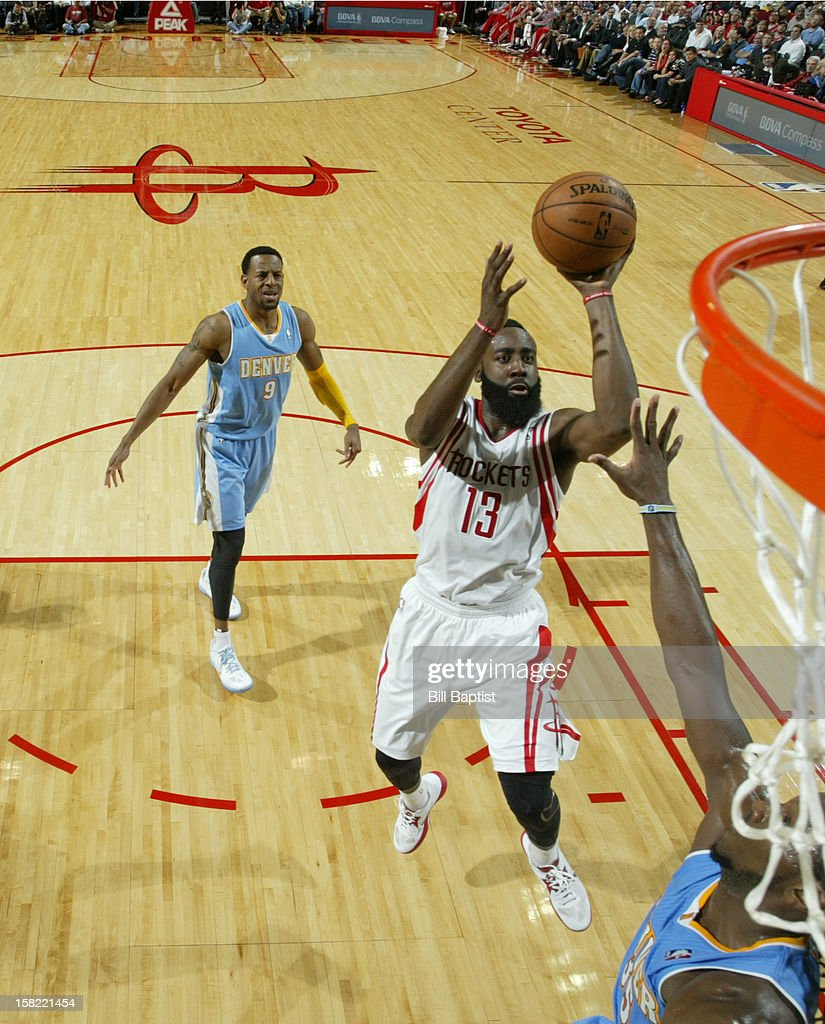 <a gi-track='captionPersonalityLinkClicked' href=/galleries/search?phrase=James+Harden&family=editorial&specificpeople=4215938 ng-click='$event.stopPropagation()'>James Harden</a> #13 of the Houston Rockets drives to the basket against the Denver Nuggets on November 7, 2012 at the Toyota Center in Houston, Texas.