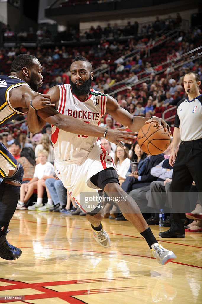 <a gi-track='captionPersonalityLinkClicked' href=/galleries/search?phrase=James+Harden&family=editorial&specificpeople=4215938 ng-click='$event.stopPropagation()'>James Harden</a> #13 of the Houston Rockets drives to the basket against the Utah Jazz on December 1, 2012 at the Toyota Center in Houston, Texas.