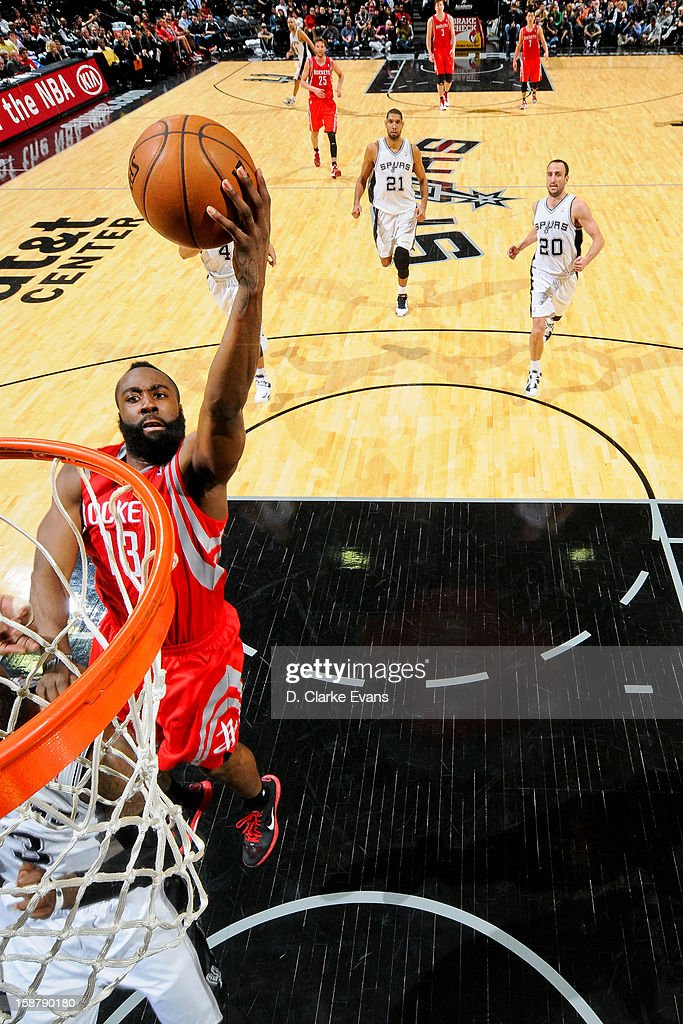 James Harden #13 of the Houston Rockets drives to the basket against the San Antonio Spurs on December 28, 2012 at the AT&T Center in San Antonio, Texas.