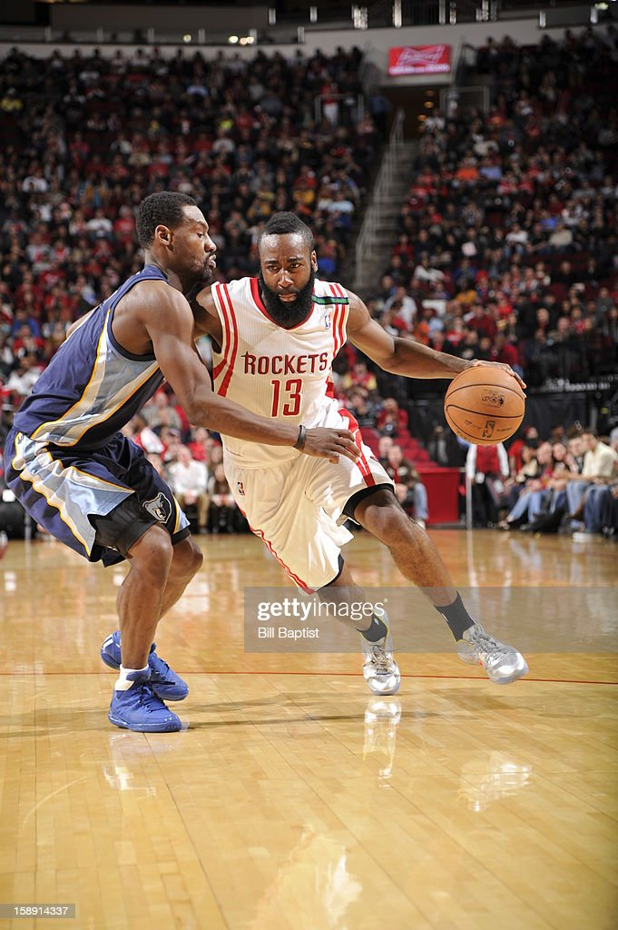 <a gi-track='captionPersonalityLinkClicked' href=/galleries/search?phrase=James+Harden&family=editorial&specificpeople=4215938 ng-click='$event.stopPropagation()'>James Harden</a> #13 of the Houston Rockets drives to the basket against the Memphis Grizzlies on December 22, 2012 at the Toyota Center in Houston, Texas.