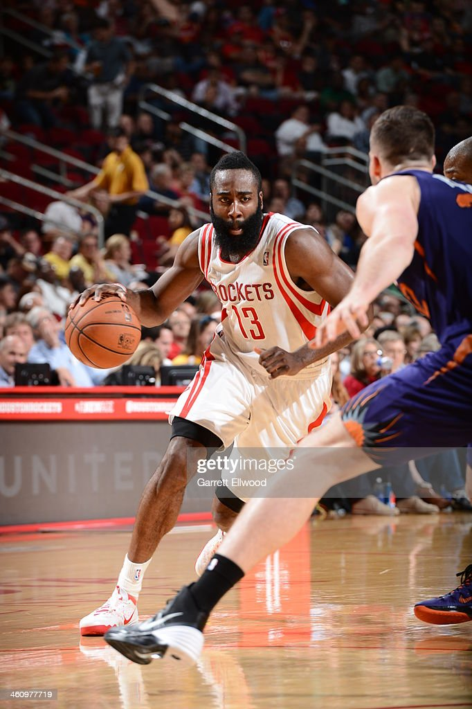 <a gi-track='captionPersonalityLinkClicked' href=/galleries/search?phrase=James+Harden&family=editorial&specificpeople=4215938 ng-click='$event.stopPropagation()'>James Harden</a> #13 of the Houston Rockets drives to the basket against the Phoenix Suns on December 4, 2013 at the Toyota Center in Houston, Texas.