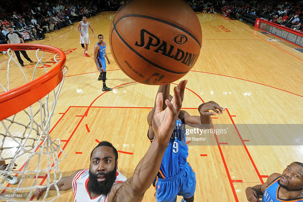 James Harden #13 of the Houston Rockets drives to the basket against the Oklahoma City Thunder on January 16, 2014 at the Toyota Center in Houston, Texas.