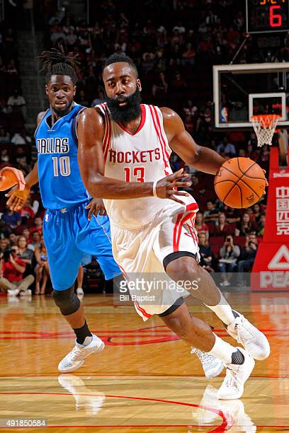 James Harden of the Houston Rockets drives to the basket against the Dallas Mavericks during a preseason game on October 7 2015 at the Toyota Center...