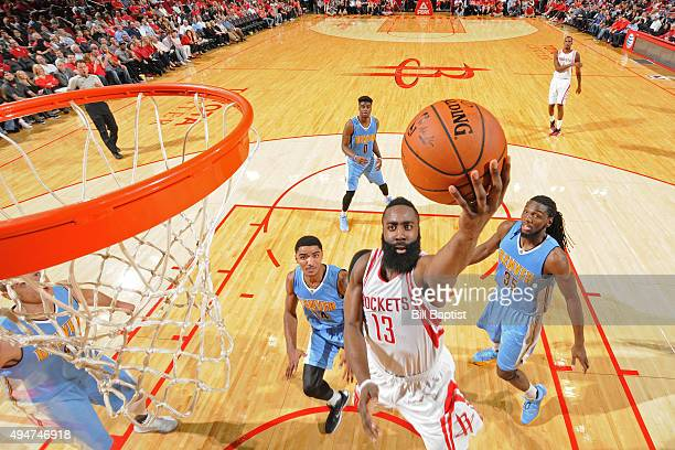 James Harden of the Houston Rockets drives to the basket against the Denver Nuggets on October 28 2015 at the Toyota Center in Houston Texas NOTE TO...