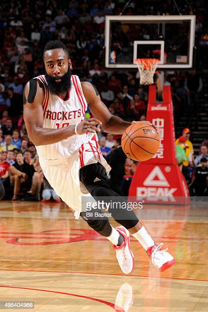 James Harden of the Houston Rockets drives to the basket against the Oklahoma City Thunder on November 2 2015 at the Toyota Center in Houston Texas...