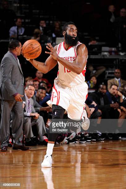 James Harden of the Houston Rockets drives to the basket against the New Orleans Pelicans on December 2 2015 at the Toyota Center in Houston Texas...