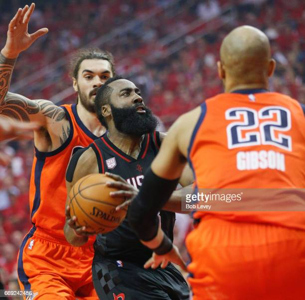James Harden of the Houston Rockets drives to the basket between Taj Gibson of the Oklahoma City Thunder and Enes Kanter during Game One of the first...