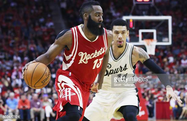 James Harden of the Houston Rockets drives with the basketball against Danny Green of the San Antonio Spurs during their game at the Toyota Center on...