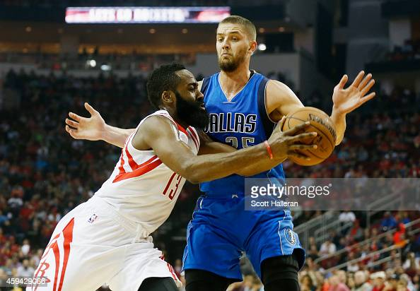 James Harden of the Houston Rockets drives with the basketball against Chandler Parsons of the Dallas Mavericks during their game at the Toyota...